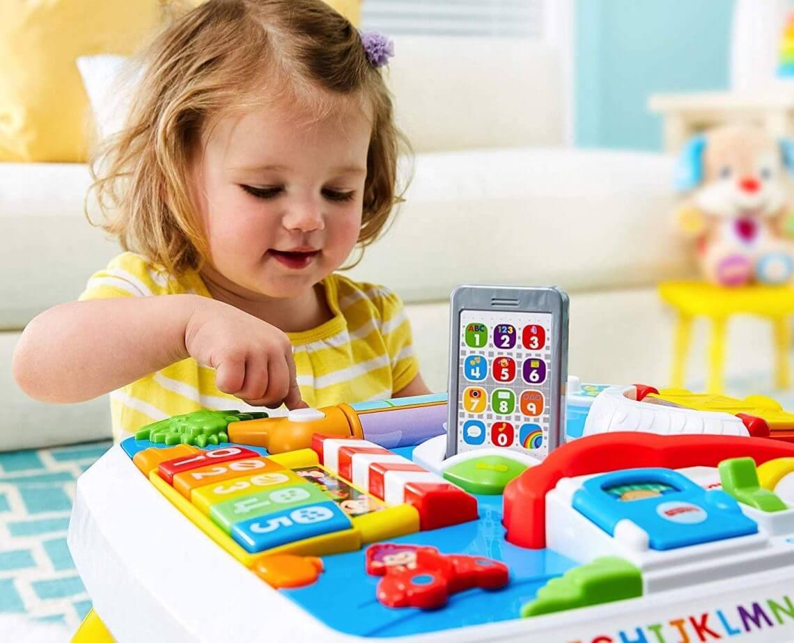 5e612c61b34d6 La table d'éveil, ou table d'activités, est très bénéfique pour le  développement du tout-petit. Elle favorise l'éveil sensoriel et la  motricité.
